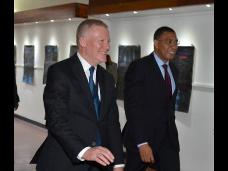 Prime Minister Andrew Holness (right) walks with Michael Lodge, secretary general of the International Seabed Authority, at a special session of the 25th assembly of the International Seabed Authority at the Jamaica Conference Centre yesterday to commemorate ISA's 25th anniversary.
