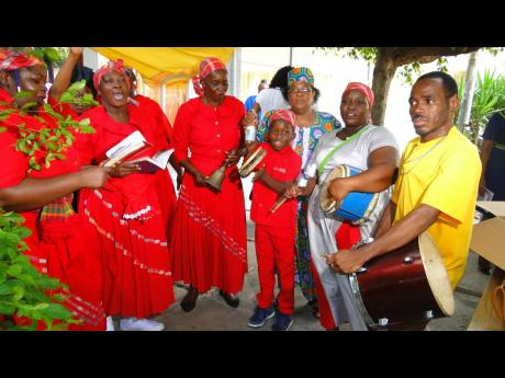 Some members of Denham Town's Mount Carmel Revival Mission Church participate in the African Caribbean Institute of Jamaica/Jamaica Memory Bank Revival  tribute to former Prime Minister Edward Seaga in downtown Kingston on June 10.