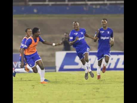 Trayvone reid (Centre) celebrates with his Kingston College teammates during the ISSA/Digicel Manning Cup final against St George's College at the National Stadium on Friday, November 30, 2018.