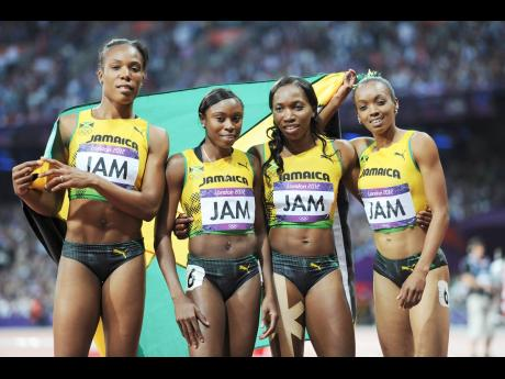 Jamaica's women's 4x400m relay team of (from left) Rosemarie Whyte-Robinson, Shericka Williams, Novlene Williams-Mills and Christine Day at the Olympic Games at in London, England on Saturday, August 11, 2012. The team, which finished third in the event, was originally given a bronze medal but since upgraded to silver after a doping sanctions on the Russian team that finished one position higher.