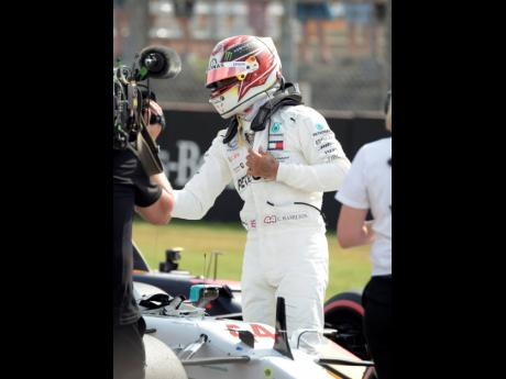 Mercedes driver Lewis Hamilton celebrates after he clocked the fastest time after the qualifying session during the qualifying Formula One session at the Hockenheimring racetrack in Hockenheim, Germany, yesterday.