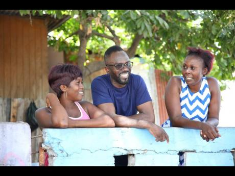 Comedian 'Ity' Ellis with his sister, Laphane Bent (left), and niece Kenisha Morris on Friday, July 26, in front of their family home in Trench Town.