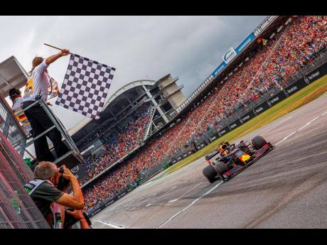 Red Bull driver Max Verstappen of the Netherlands crosses the finish line to win the German Formula One Grand Prix at the Hockenheimring racetrack in Hockenheim, Germany, yesterday.