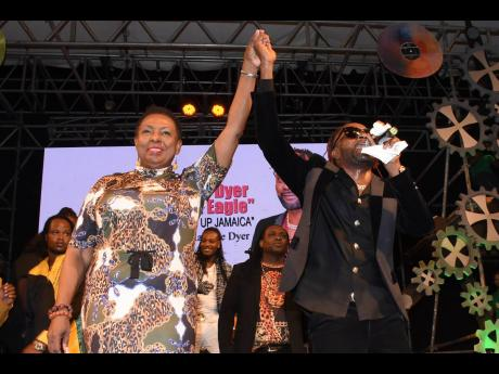 Winner of the 2019 Festival Song contest Loaded Eagle with Minister of Culture Olivia Grange.