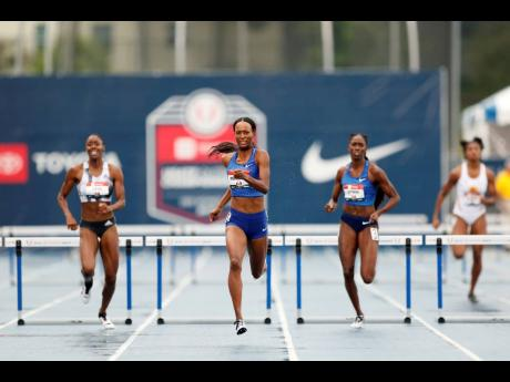 Dalilah Muhammad (centre) eyes the finish line as she wins the women's 400m hurdles in world record time at the US Championships in Des Moines, Iowa, on Sunday.