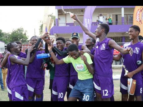 Kingston College players celebrate their win of the first Yardie Sports Challenge Cup, held on the school grounds on Sunday.