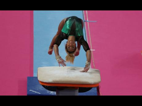 Danusia Francis of Jamaica competes on the vault in women's individual all-around artistic gymnastics at the Pan American Games in Lima, Peru, yesterday.