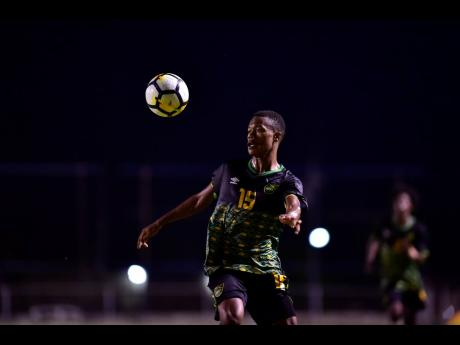 Jamaica Under-23 footballer Deshane Beckford in action against St Kitts and Nevis in their Olympic qualifying match at the Anthony Spaulding Sports Complex on Sunday, July 21.