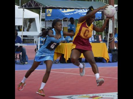 Springers' Sierra Coward (left) puts pressure on Holmwood Technical's Ryoho Jones during their semi-final matchup of the AFNA Champion of Champions High School Netball Tournament held at the Leila Robinson Court on July 20, 2018. Holmwood won 45-14.