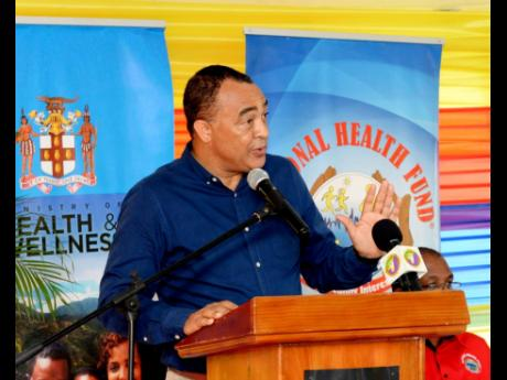 Minister of Health and Wellness Dr Christopher Tufton speaks at the commissioning of a new elevator by the Ministry of Health and Wellness, the National Health Fund and the South East Regional Health Authority, at the Spanish Town Hospital, St Catherine, last Friday.
