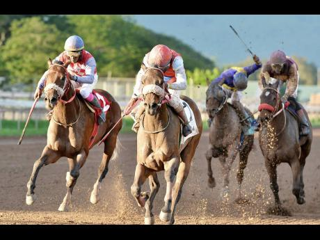 ANOTHER VIGOROUS (centre), ridden by jockey Dane Nelson powering to victory in the 10th race on Saturday, December 29, 2018.