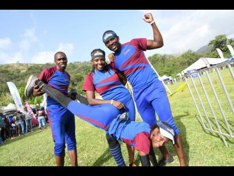 The fun and games, mixed with hard work, paid off for Supligen Vikings, who were the overall winners of the Guardsman Games. From left: team members Allay Ashman, assisting ingrid Blackwood in a high plank  push-up, winner of the elite females 2019 title, Francine Brown and Gavin Francis struck a pose for our cameras.