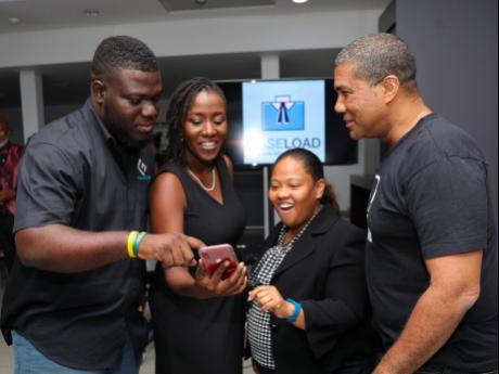 From left: Dean Morris, sales executive at Firm Solutions and Caseload; Ano Miller Sewell, founder and managing director of Firm Solutions Jamaica Ltd; Samantha Daley, attorney-at-law at CISOCA; and Sheldon Powe, CEO of Innovate10X, have their eyes glued to the tablet as they explore the Caseload app.