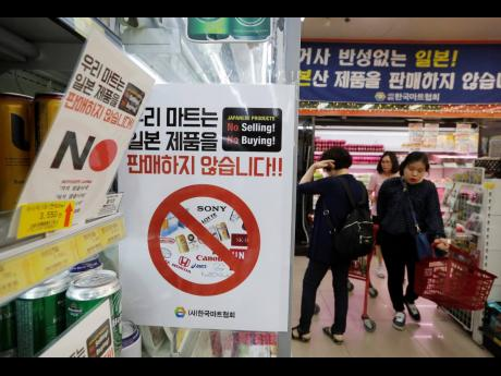 In this July 9, 2019 photo, notices campaigning for a boycott of Japanese-made products is displayed at a store in Seoul, South Korea.