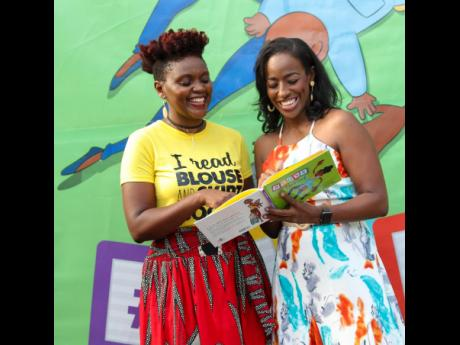 Carlette DeLeon (right), author of 'Joys of Parenting', shares with  Tanya Batson Savage, owner of publishing house Blouse & Skirt Books,  during the recent book launch.