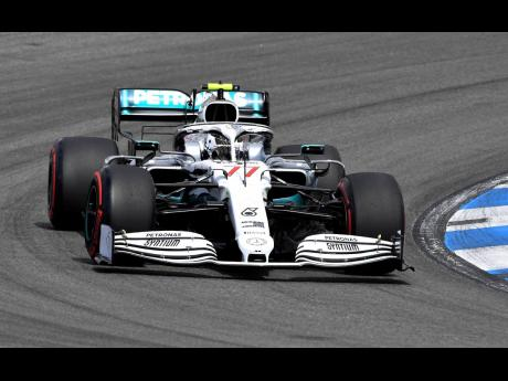 In this file photo dated Saturday, July 27, Mercedes driver Valtteri Bottas of Finland steers his car during the qualifying Formula One session at the Hockenheimring racetrack in Hockenheim, Germany.