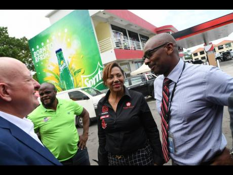 Petrol dealer Annette Wong-Lee is flanked by (from left) GB Energy Jamaica CEO Mauricio Pulido, Managing Director of BucMars Inc Dwight Morgan, and NCB Oxford Place Branch Manager Dean Simpson, at the opening of her Texaco station at 94M Old Hope Road in Kingston, on Wednesday, July 31, 2019.