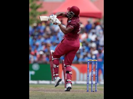 West Indies' Kieron Pollard hit a six during the first Twenty20 international cricket match against India, yesterday, in Lauderhill, Florida. Pollard top-scored 49 as the West Indies lost by four wickets.