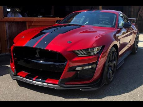 In this Tuesday, July 31, 2019, photo the 2020 Shelby GT500 is displayed during a Ford press conference in the Detroit suburb of Clawson, Michigan.