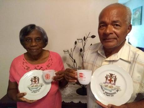 Hilary Campbell and her husband, John, show off their precious Independence memorabilia.