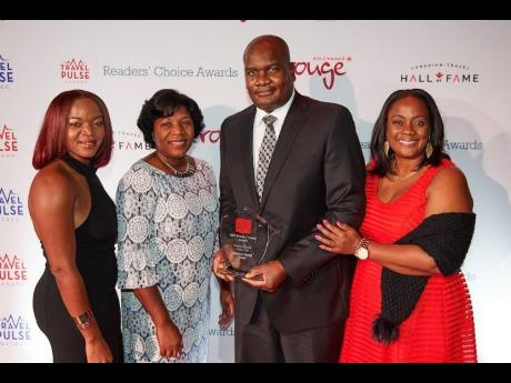 Angella Bennett, regional director, Jamaica Tourist Board Canada (right), with members of the Jamaica Tourist Board team in Canada at TravelPulse Canada's Readers' Choice Awards Gala in Toronto. Others pictured from left: Judy Nash, Jacqueline Marshall, and Dan Hamilton.