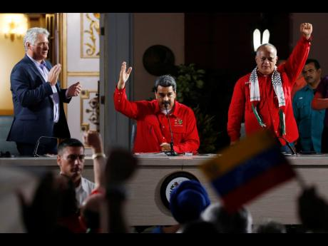 From left: Cuba's President Miguel Diaz-Canel Venezuela's President Nicolas Maduro, and Venezuelan Socialist Party President Diosdado Cabello, attend the closing ceremony of the Sao Paulo Forum at Miraflores presidential palace in Caracas, Venezuela, Sunday, July 28. The Sao Paulo forum, held almost annually and hosted by Cuba last year, was founded as Latin American leftists sought to re-organise after the fall of the Berlin Wall in 1989.