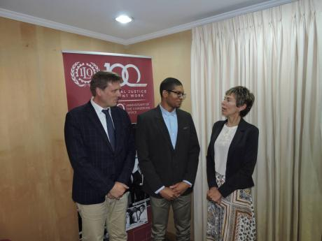 Matthue Prescott (centre), first-place winner of the International Labour Organization (ILO) Future of Work Essay Competition, in conversation with Lars Johansen (left), deputy director of the ILO Office for the Caribbean, and Claudia Coenjaerts (right), director of the ILO Office for the Caribbean.