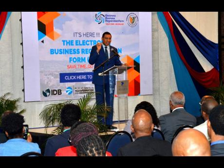 Prime Minister Andrew Holness emphasises a point while delivering the keynote address at the launch of the Companies Office of Jamaica's Electronic Business Registration Form (eBRF) at The Jamaica Pegasus hotel in New Kingston on Wednesday.