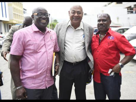 (From left) Sherdon Samuels, President of the Hanover Football Association, Michael Ricketts, Jamaica Football Federation President and Dalton Wint, JFF General Secretary, are all smiles at the JFF's Annual General Meeting and voting congress held on Saturday, September 16, 2017.