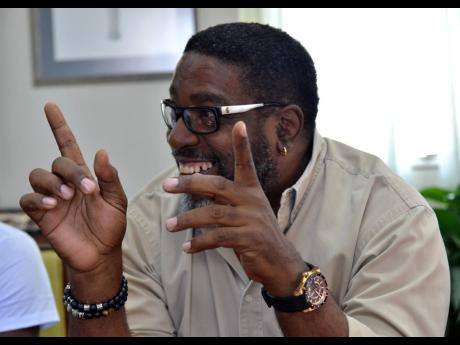 Squeeze speaking at The Gleaner's Dancehall Forum.