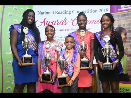 The national champions for the five age groups in the Jamaica Library Service's National Reading Competition pose with their awards at yesterday's presentation ceremony at The Jamaica Pegasus hotel. From left are Sanikia Powell-Morgan of Manchester, Natajia Newton of St James, Travis Kerr of St James, Jo'Anna Hill of St James, and Kaliesha Gager of Trelawny.