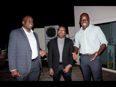 Senior managers at the National Commercial Bank (NCB) are captured enjoying the moment during NCB's annual staging of the Monday Club. From left are Kevin Ingram, Vernon James and Antonio Spence.