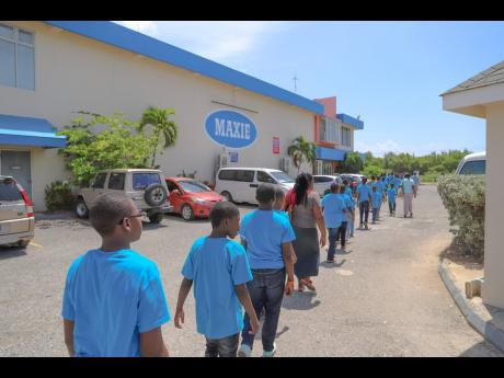 Children from the Jamaica National Children's Home as well as staff members and FLOW volunteers make their way to Maxi Department Store in Portmore for  a day of shopping.