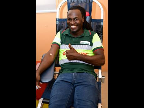 Daine Winkle from Red Stripe's brewing department gives a thumbs up after donating one unit of blood. For the last 19 years, he has been contributing to the Blood Bank.