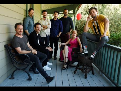 Andy Muschietti (far right) director of 'It Chapter Two,' poses for a portrait with cast members (from left) James McAvoy, Jay Ryan, Bill Hader, James Ransone, Andy Bean, Isaiah Mustafa and Jessica Chastain at Heritage Square Museum in Los Angeles. There were high expectations for the sequel opening, September 5, especially since the first film became the highest-grossing horror movie of all time.