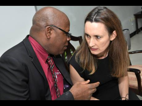 Melanie Subratie, chairman and CEO of Stanley Motta Limited, consults with Leighton McKnight, partner of auditing firm PricewaterhouseCoopers, at Stanley Motta's annual general meeting on Tuesday, September 10.