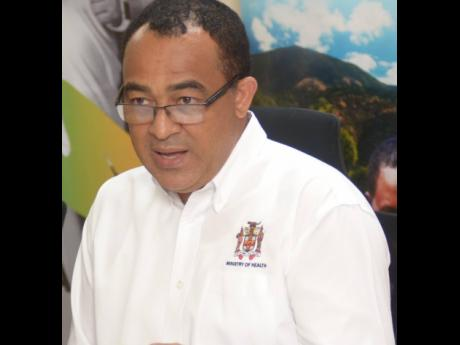 Minister of Health, Dr Christopher Tufton speaking at an emergency press conference at the Ministry of Health in Kingston in January to address news of an outbreak of dengue. The Ministry is now battling an outbreak in St James.