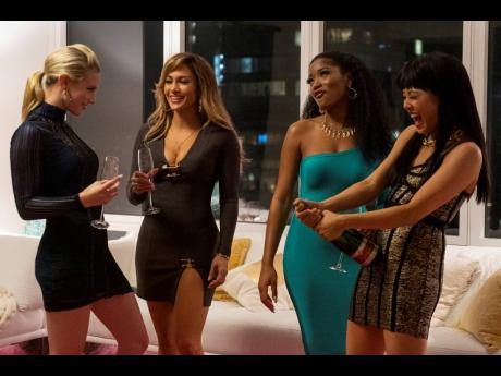 This image released by STXfilms shows (from left) Lili Reinhart, Jennifer Lopez, Keke Palmer, and Constance Wu in a scene from 'Hustlers', which opened in theatres on September 13.