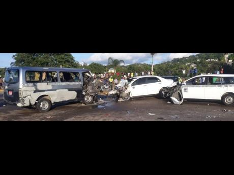 The three vehicles involved in the accident along the Flankers main road in St James yesterday. The driver of the middle vehicle died on the spot. The bus driver succumbed to his injuries at hospital.