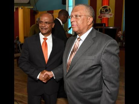 Dr. Peter Phillips (right), president of the People's National Party, and Peter Bunting