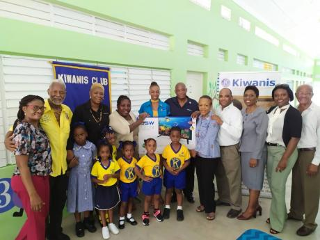 Kiwanians handing over a television set to the Stimulation Plus Early Childhood Development Centre.