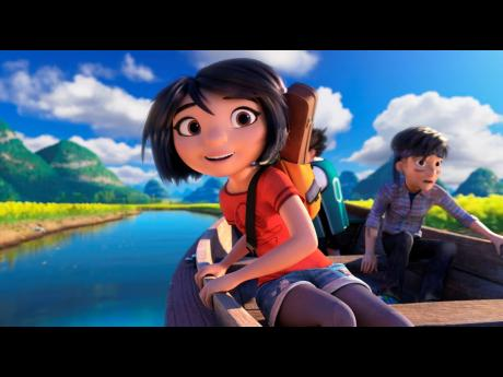 This image released by DreamWorks Animation shows characters Yi (left), voiced by Chloe Bennet, and Jin, voiced by Tenzing Norgay Trainor, in a scene from 'Abominable'.