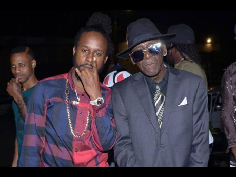 Recording artiste Popcaan poses for a photo op with co-star Louie 'Teddy Bruckshut' Rankin at the premiere of 'The Intent 2', held at The Courtleigh Auditorium, September 27, 2018.