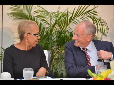 Minister of Science, Energy and Technology Fayval Williams converses with MPC Capital AG CEO Ulf Hollander at the MPC Renewable Energy Forum held at Spanish Court Hotel, New Kingston, on Tuesday, October 1, 2019.