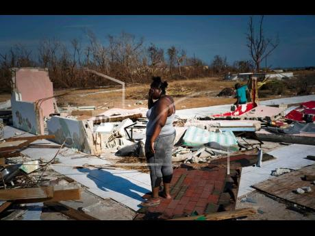 AP  A woman is overcome with grief as she looks at her house destroyed by Hurricane Dorian in High Rock, Grand Bahama, Bahamas, on Friday, September 6. Constant policing of expanding regulatory regimes are seen as competing with other responsibilities of government, especially in times of disaster.