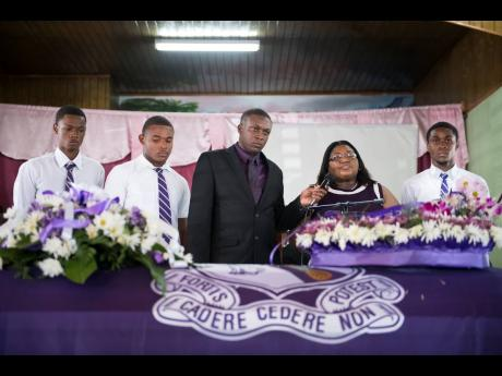 Kingston College representatives pay tribute to the late Twayne Crooks at Sunday's thanksgiving service. From left are Shamari Jennings, Oshane Peart, coach Richard Smith, vice-principal Juliet Wilson and track team captain Shanthamoi Brown.