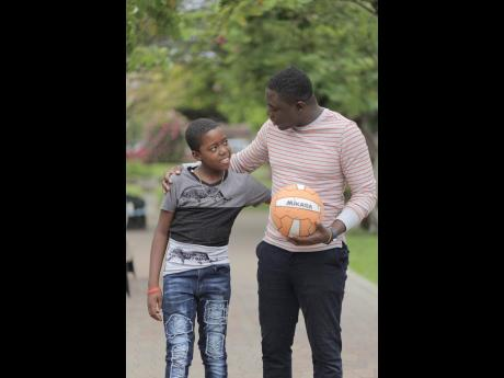 Managing director of the Friends of a Child Help Foundation Jason Evans with mentee Richardo Whyte.