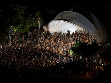 Thousands gather around the stage at Kanye West's Sunday Service concert held at Emancipation Park, New Kingston, on Friday night.
