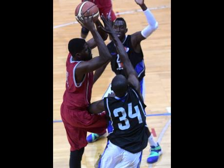 File UWI Running Rebels player Ramal Carbon (left) drives to the hoop between Urban Knights' Tommy McDonald (background) and Arthur Martin in last season's opening National Basketball League game at the National Arena, which was played on Saturday, February 10, 2018.