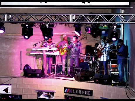 Dancehall-reggae crooner Sanchez enters the stage at Tracks and Records, accompanied by his live band for the first of the R